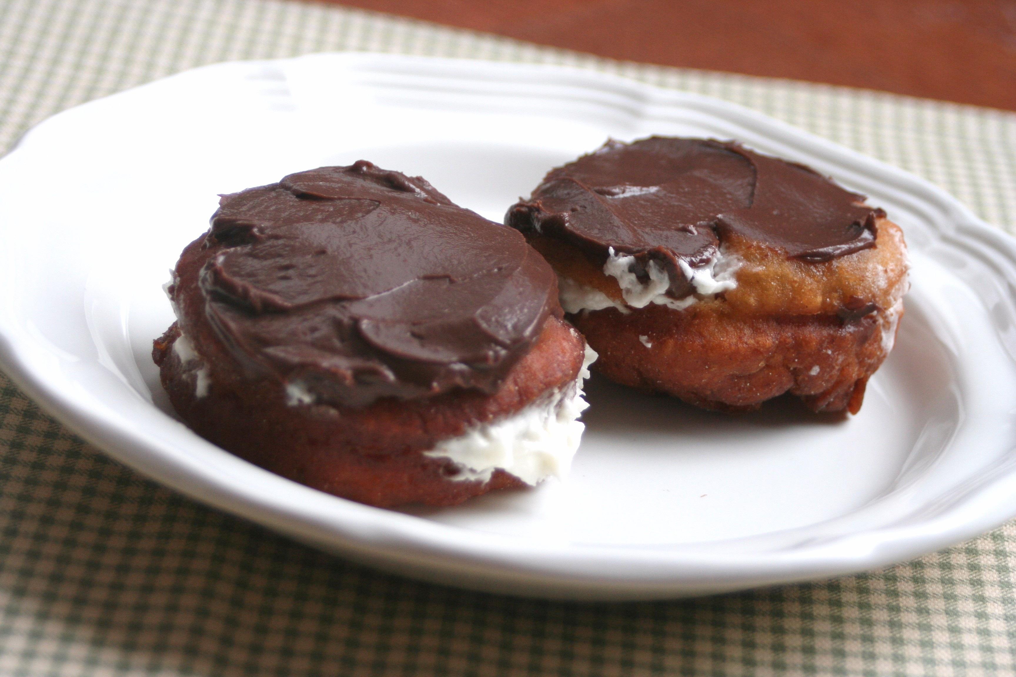 Chocolate Cream Filled Vanilla Sugar Doughnuts Recipe — Dishmaps